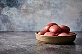 Red potatoes in a ceramic bowl