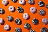 Doughnuts on orange background