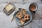 Hot cross buns, butter and tea