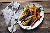 Roasted heritage carrots-with lemon and cumin on a plate