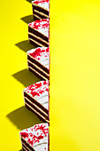 Red velvet cake on yellow background