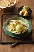 Meat dumplings with leek broth