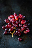 Fresh red grapes on a dark background