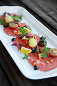Beef carpaccio with tomatoes