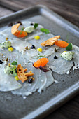 Fish carpaccio with caviar