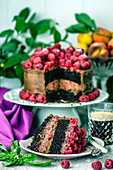 Chocolate cake with raspberries and coffee in a crystal glass