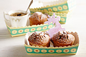 Mini spiced chocolate cakes with coconut flakes