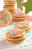 Ischler shortcrust biscuits with almonds, coffee cream, glaze and coloured sugar sprinkled
