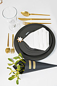Festive place setting in black, white and gold