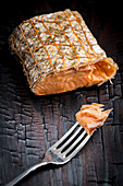 Smoked salmon in a net with a fork