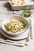 Roast chicken lasagne with brie and rocket pesto