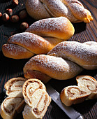 Mini yeast dough nut twists filled with marzipan