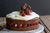 Easter cake with raspberries, sour cream and passion fruit