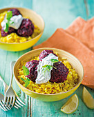 Beetroot lentil balls on turmeric rice