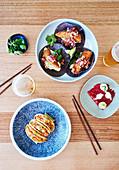 Fisch-Tacos, panierter Fisch und Sashimi