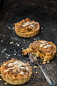 Apple tartlets with flaked almonds