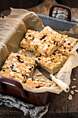Butter cake slices with pomegranate seeds and flaked almonds