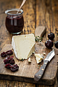 Cheese and cherry chutney on a chopping board