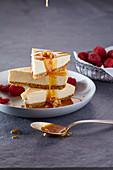 Cheesecake with raspberries and caramel sauce