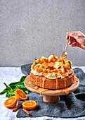 Baba Au Rhum mit Orangen, Physalis und Kumquats