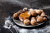 Doughnut holes with caramel sauce