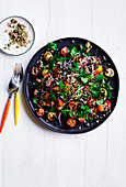 Tomato and mixed-grain salad with black garlic dressing