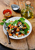 Sweet potato salad with vegetables and goat's cheese