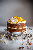 Hummingbird cake – pineapple and banana cake with cream cheese frosting and fruit