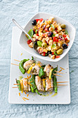 Swordfish roll skewers with a bread salad