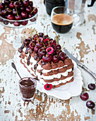 Chocolate meringue cake with cherries
