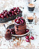 Chocolate pancakes with cherries