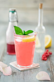 Sharbat (Persian lemonade) with redcurrant syrup, lemon and rose water