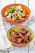 Tapas: artichoke salad and prunes wrapped in bacon (Spain)