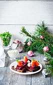 Crostini with beetroot, salmon and sour cream