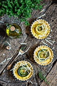 Savoury tartlets with courgette and parmesan in a baking dish
