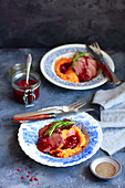 Goose breast with mashed sweet potatoes and sour cherry sauce