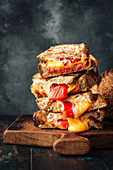 Toasted sandwiches with chorizo, cheese and grilled peppers