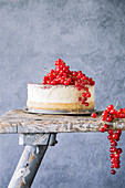 Profiterole cake with redcurrants