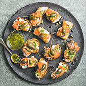 Salmon crostini with cream-cheese, watercress, capers and pesto sauce