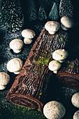 A dark chocolate Yule log with meringue mushrooms