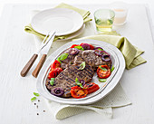 Grilled beef fillet steaks with grilled tomatoes and grappa onions
