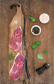 Lamb entrecote and seasonings on cutting board
