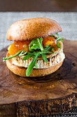A slider with grilled goat's cheese, rocket and mango chutney