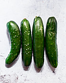 Four cucumbers (seen from above)