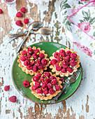Raspberry pistachio tarts