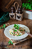 Potato gnocchi with peas and cream