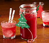 Homemade berry and lime in a tall glass made with frozen forest berries (Christmas gifting)