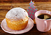 A mini Panettone with a cup of coffee