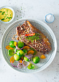Chilli rump steak with a carrot and Brussels sprouts salad
