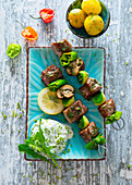 Mediterranean lamb and vegetable skewers with herb quark and potatoes